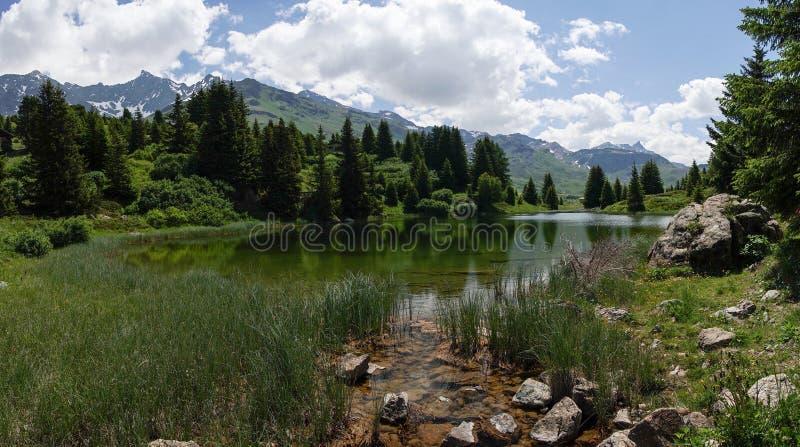 Idyllic mountain lake landscape in the Swiss Alps. An idyllic mountain lake landscape in the Swiss Alps stock photo