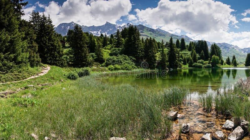 Idyllic mountain lake landscape in the Swiss Alps. An idyllic mountain lake landscape in the Swiss Alps royalty free stock photos