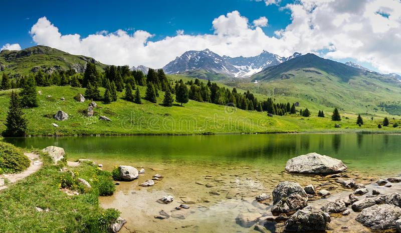 Idyllic mountain lake landscape in the Swiss Alps near Alp Flix. An idyllic mountain lake landscape in the Swiss Alps near Alp Flix royalty free stock photos
