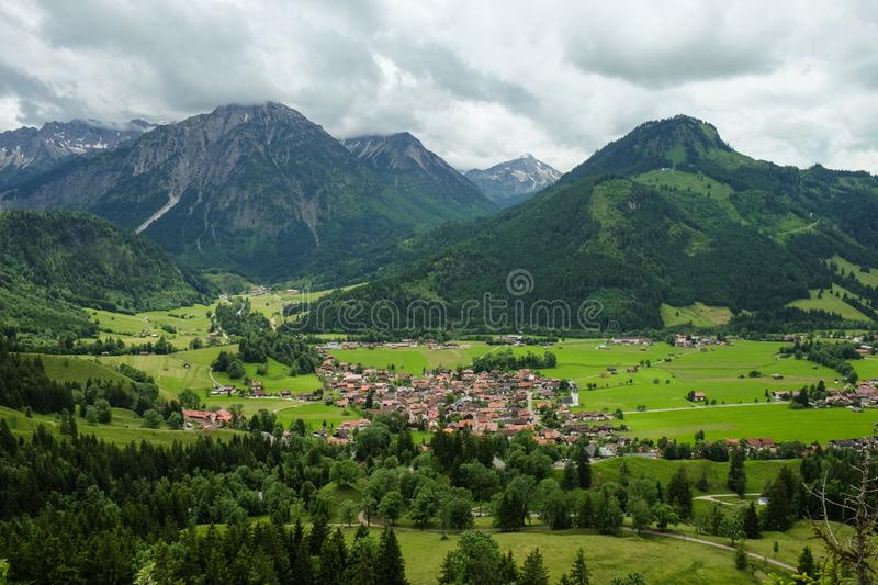 Idyllic mountain landscape with a small village and mountains in the background royalty free stock photos