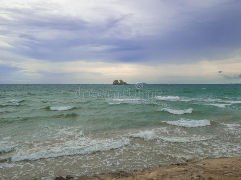 Idyllic ocean under cloudy sky in vacation time. Summer concept royalty free stock photo