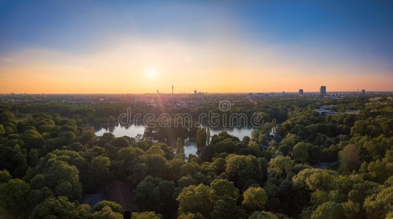 An idyllic park in the Englischer Garten of Munich with a beautiful lake in an aerial view. An idyllic park in the Englischer Garten of Munich with a beautiful stock images