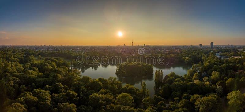 An idyllic park in the Englischer Garten of Munich with a beautiful lake as an aerial. An idyllic park in the Englischer Garten of Munich with a beautiful lake royalty free stock photo
