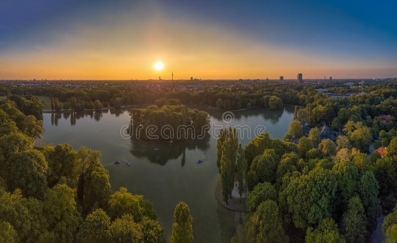 An idyllic park in the Englischer Garten of Munich with a beautiful lake as an aerial from a drone. An idyllic park in the Englischer Garten of Munich with a stock photo