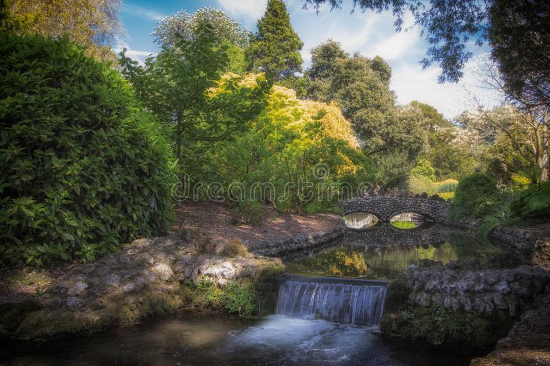 Idyllic picturesque landscape with waterfall and beautiful stone stock photo