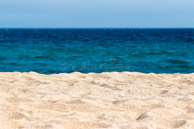 Idyllic sand beach. Background in a sunny day royalty free stock photography