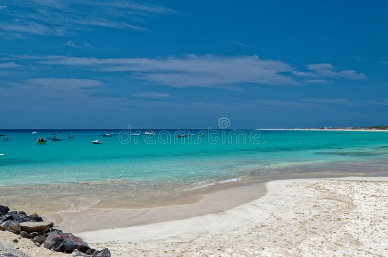 Panoramic view of idyllic sandy beach on the island Sal, Cape Verde. Idyllic sandy beach near center of Santa Maria. Island Sal, Cape Verde stock image