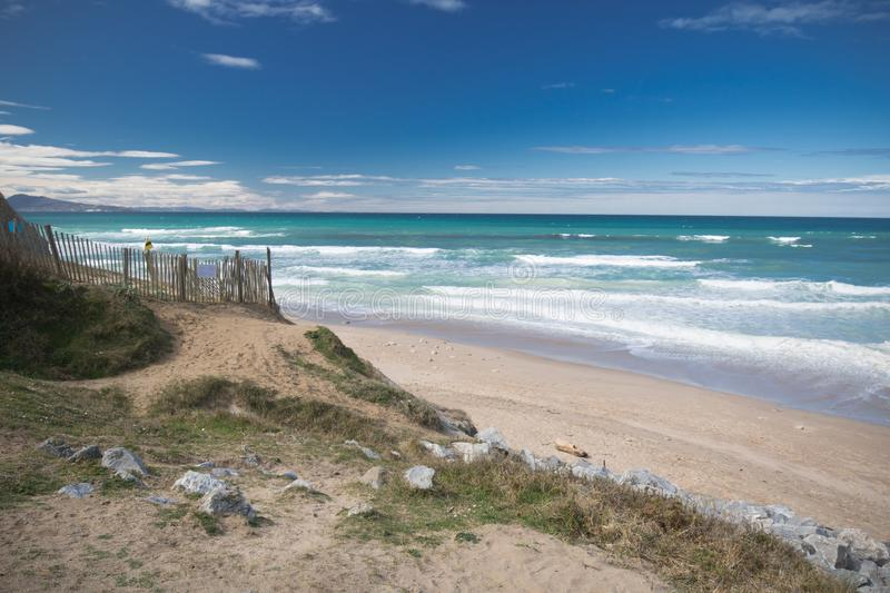 Idyllic sandy beach in sunny blue sky by atlantic ocean in bidart, basque country, france royalty free stock photo