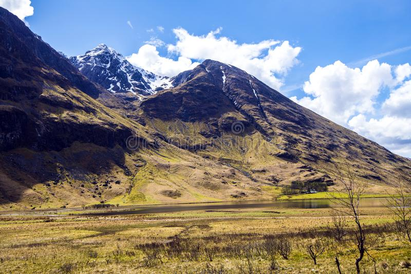 Beautiful Loch Achtriochtan lies at the foot of the Bidean nam bian group of peaks in Glen Coe in the Highlands of Scotland royalty free stock photo