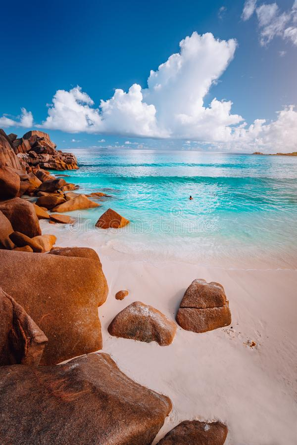 Idyllic scenery sea cloudscape of Grand Anse beach in La Digue island, Seychelles. Nature background stock photography