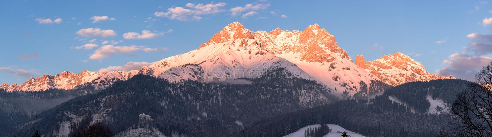 Idyllic snowy mountain peaks, setting sun in winter, landscape, Alps, Austria. Idyllic scenery with snowy mountains in the evening sun, Alps, Austria winter peak royalty free stock images