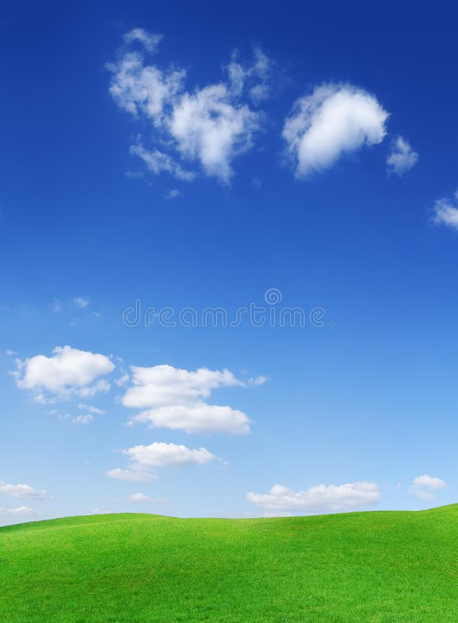 Idyllic view, green hills and blue sky with white clouds royalty free stock image