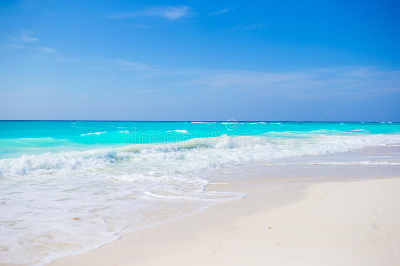 Idyllic tropical beach on Cuba in Caribbean with white sand, turquoise ocean water and blue sky. Idyllic tropical beach on Cuba in Caribs with white sand stock photography