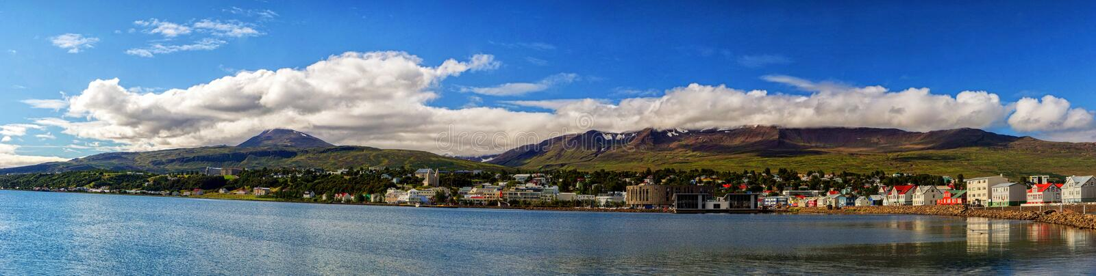 Idyllic view of mountains, ocean and clouds stock photography