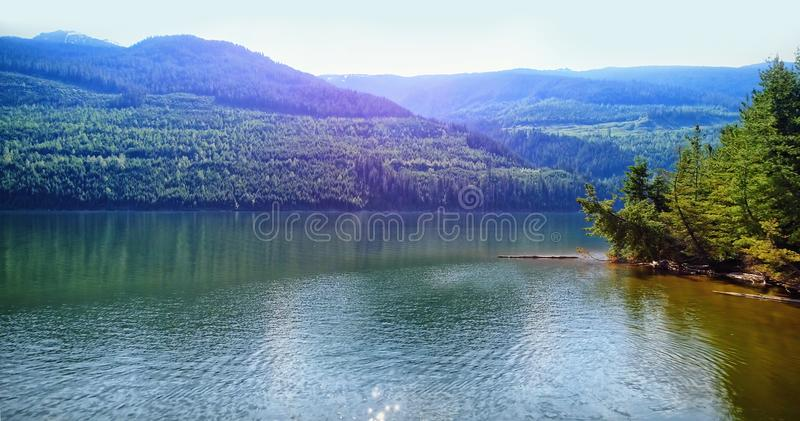 Idyllic view of river and mountains against sky vector illustration