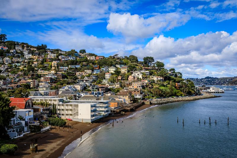 Idyllic view of the south end of Sausalito waterfront on a clear sunny day with fluffy clouds and a few birds. Idyllic view of the south end of Sausalito royalty free stock image