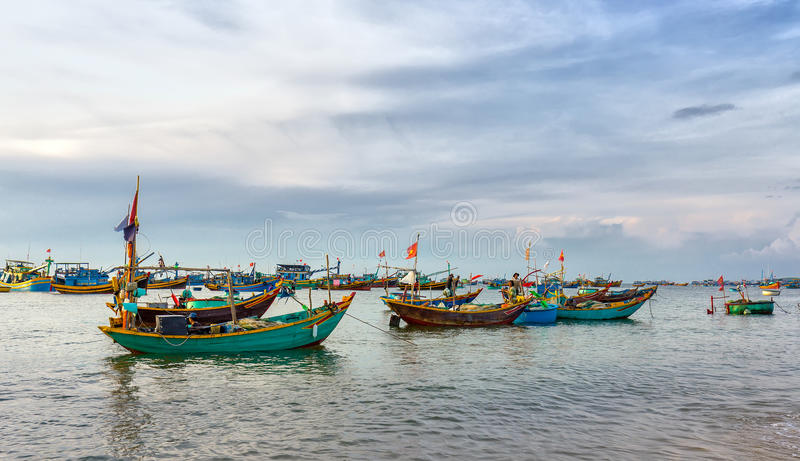 Ier fishing at Mui Ne beach. Phan Thiet, Vietnam - July 26th, 2016: Pier fishing at Mui Ne beach in the morning when the fishermen prepare for a trip out to sea stock photography