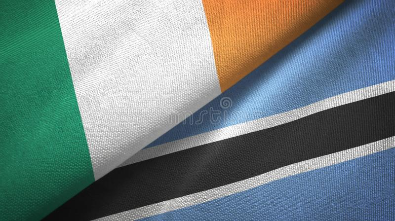 Ierland en Botswana twee vlaggen textieldoek, stoffentextuur royalty-vrije illustratie