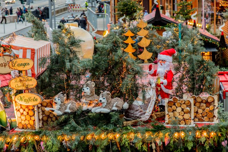 Iew of the Christmas decorations, toys and scenery houses on the Christmas market in Dresden on the square Altmarkt. Dresden, Germany - december 14, 2018: view royalty free stock image