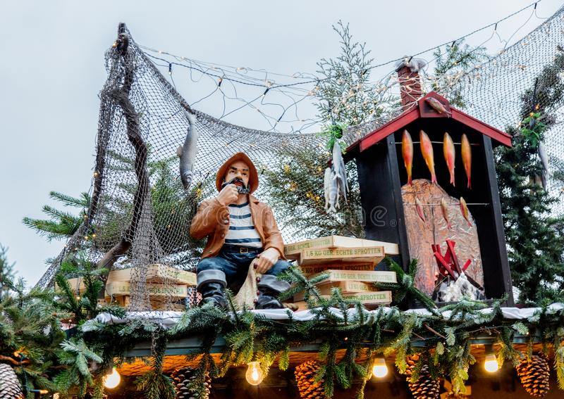 Iew of the Christmas decorations, toys and scenery houses on the Christmas market in Dresden on the square Altmarkt. Dresden, Germany - december 14, 2018: view royalty free stock photography