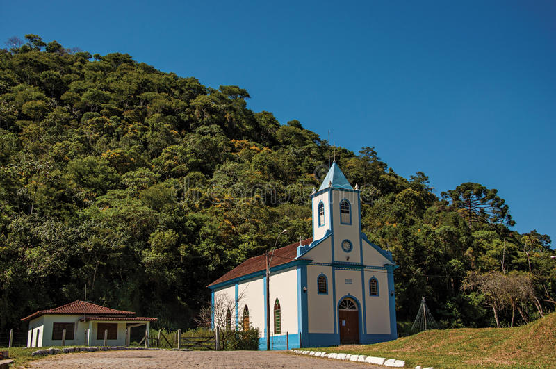 Iew of small church with belfry and forest in Visconde de Mauá. Visconde de Mauá, Brazil - January 19, 2015. View of small church with belfry and forest royalty free stock photo