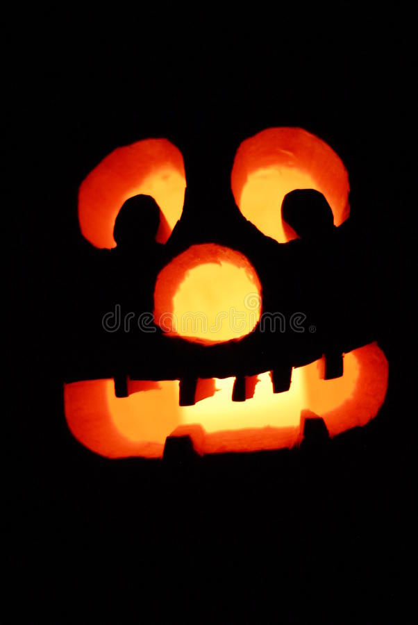 Only if in the Jack-O-Lanterns light will you be safe on Halloween night. royalty free stock photo