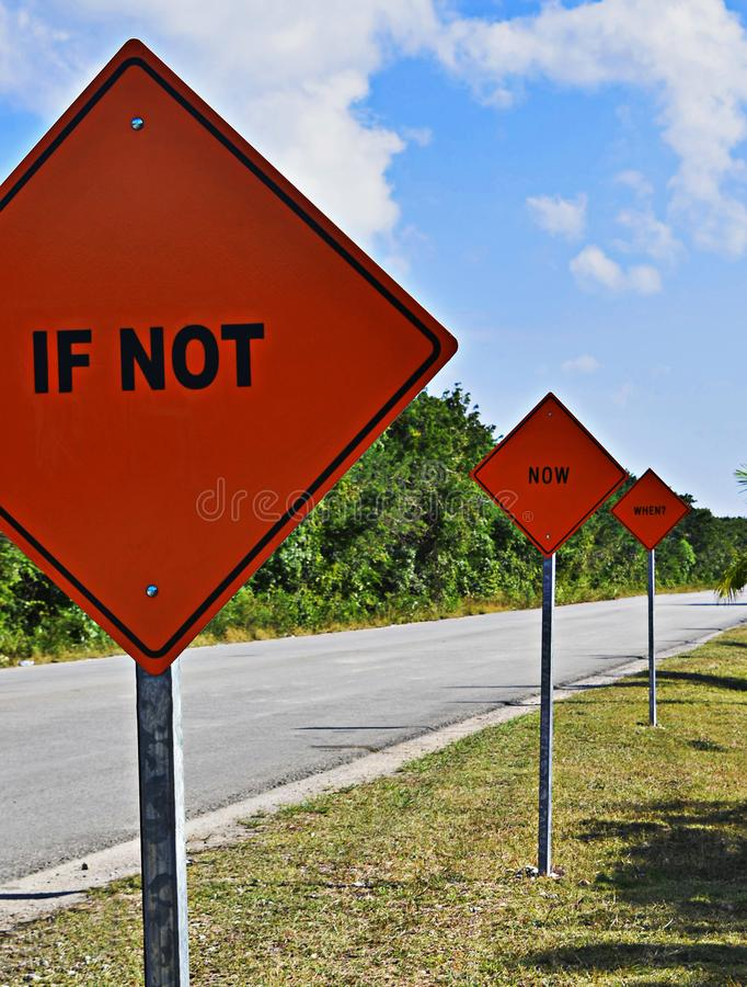 If not now when? Orange motivational signs. If not now when? Orange motivational signs located in the main road of Tulum, Mexico royalty free stock image