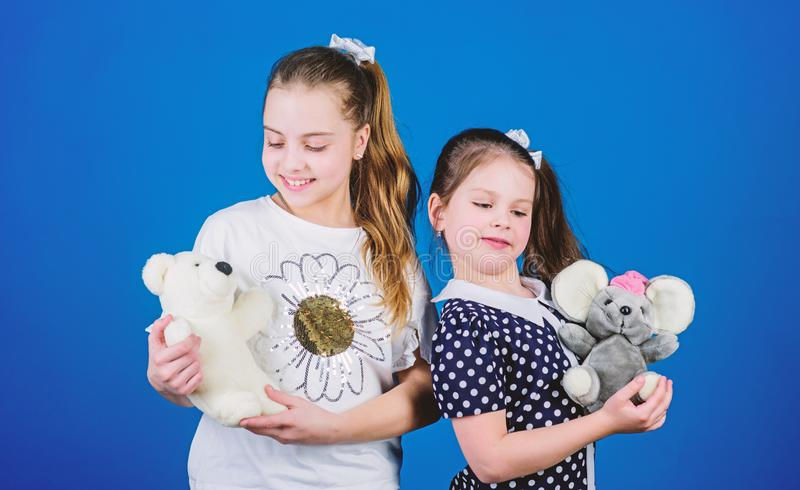 If you carry your childhood you actually never get older. Kids cute girls play with soft toys. Happy childhood. Child. Care. Sisters or best friends play with stock photography