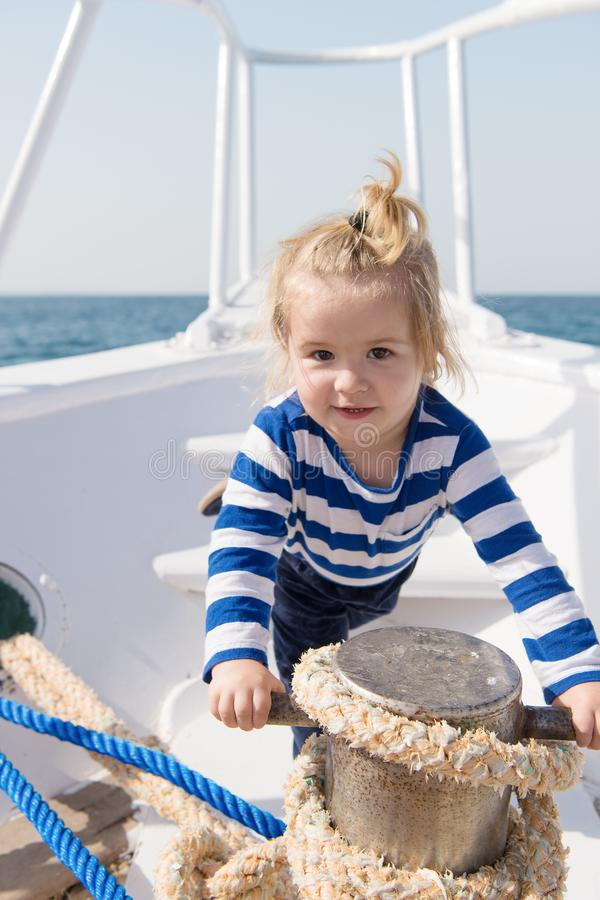 If you choose follow animators steps every day will seem like never ending party. Baby enjoy sea cruise. Boy sailor. Travel sea. Boy sea yacht travel around royalty free stock photo