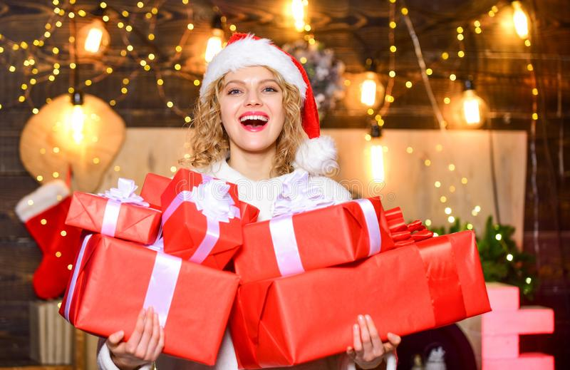 If you have lot of gifts to wrap then turn it into gift wrapping party. Buy lots of gift wrappers. She deserves all best. Ribbons bows accessories. Girl santa royalty free stock image