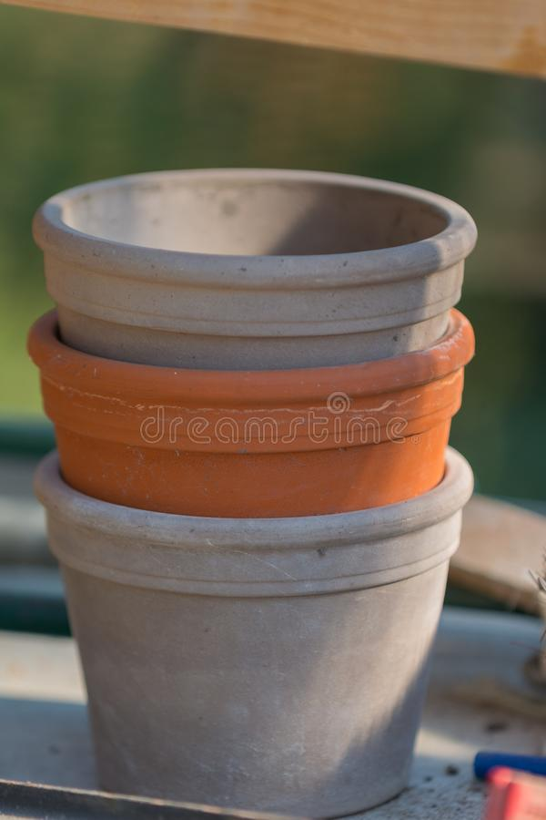 Three plant pots stacked grey - red- grey stock images