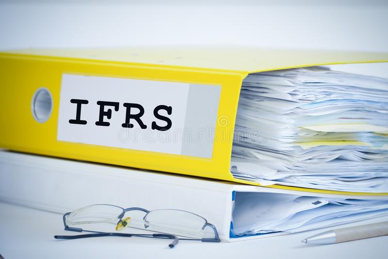 Ifrs standards folder with documents. Ifrs standards folder with accounting documents and financial reports royalty free stock photography