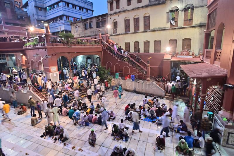Iftar party at Nakhoda Masjid, Kolkata, India. KOLKATA, WEST BENGAL, INDIA - MAY 27 2019 : Muslim devotees breaking their day long fasting by having food and stock photography