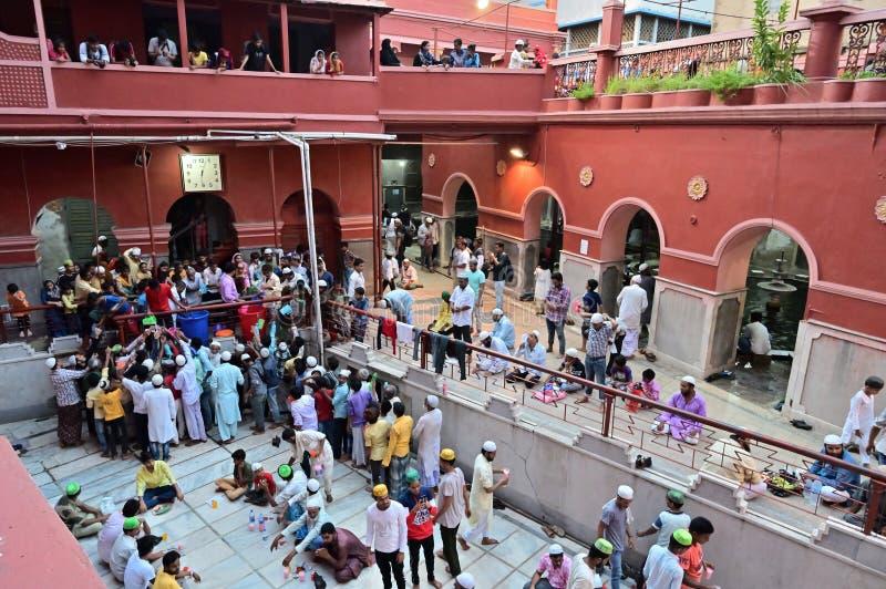 Iftar party at Nakhoda Masjid, Kolkata, India. KOLKATA, WEST BENGAL, INDIA - MAY 27 2019 : Muslim people breaking their day long fasting by having food and stock images