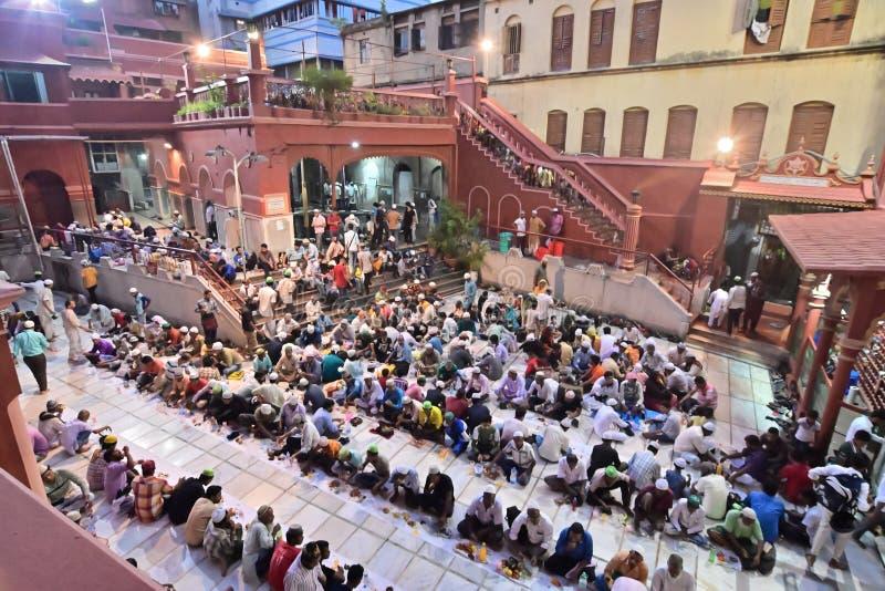 Iftar party at Nakhoda Masjid, Kolkata, India. KOLKATA, WEST BENGAL, INDIA - MAY 27 2019 : Muslim people breaking their day long fasting by having food and royalty free stock photography