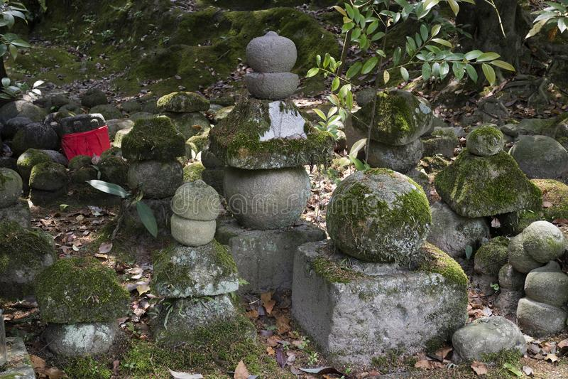 Iga Ueno - Japan, June 1, 2017: Piled up stones symbolizing. Jizo covered with moss in Ueno park royalty free stock images