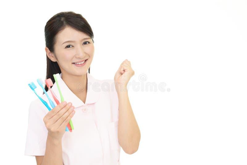 Igienista dentale sorridente immagine stock