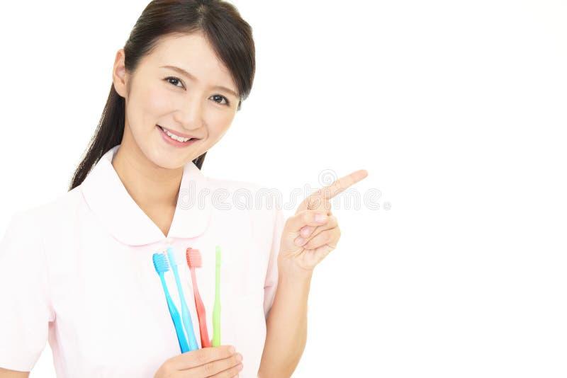 Igienista dentale sorridente fotografie stock