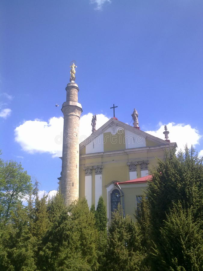 Iglesia de Chatholic + alminar turco, Kamenets-Podolskiy, Ucrania fotografía de archivo libre de regalías