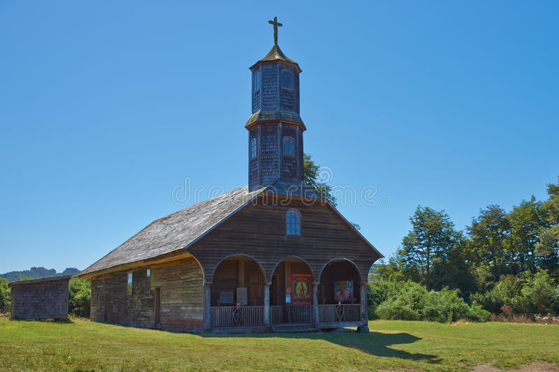Iglesia de Colo. Historic wooden church, Iglesia de Colo, built in the 17th century by Jesuit missionaries on the island of Chiloe in Chile stock photography