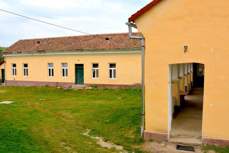 Iglesia evangélica sajona medieval fortificada en el pueblo Barcut, Bekokten, Brekolten, Transilvania, Rumania imágenes de archivo libres de regalías