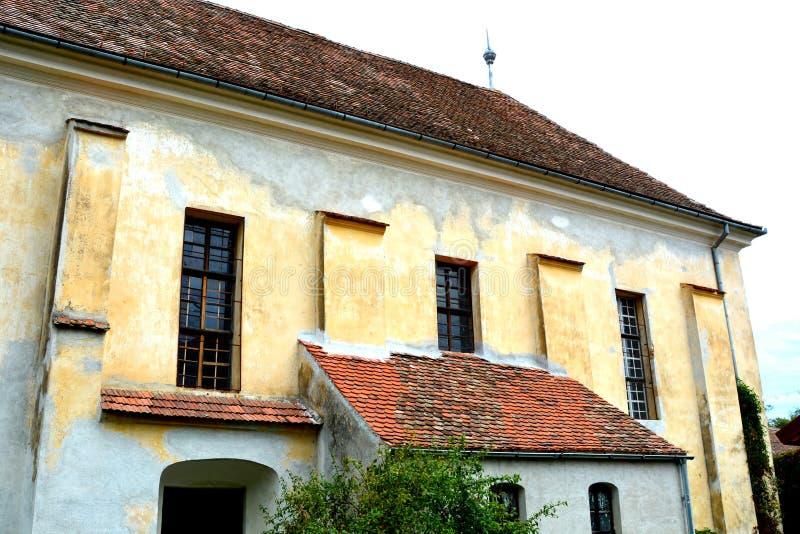 Iglesia evangélica sajona medieval fortificada en el pueblo Barcut, Bekokten, Brekolten, Transilvania, Rumania imagenes de archivo