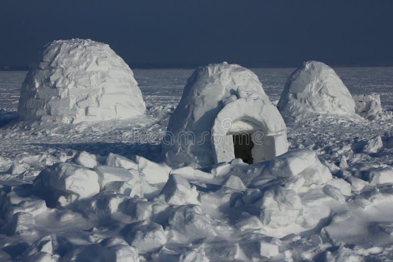 Igloo. Eskimos village. Winter dwelling of Eskimos. Igloo. Eskimos village. Winter background stock photos