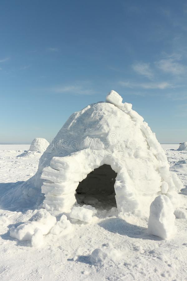 Igloo standing on a snowy glade. In the winter stock photography