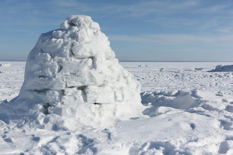 Igloo standing on a snowy glade royalty free stock photography