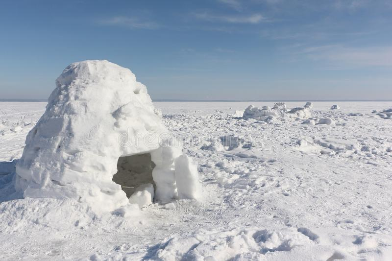 Igloo standing on a snowy glade. In the winter stock photo