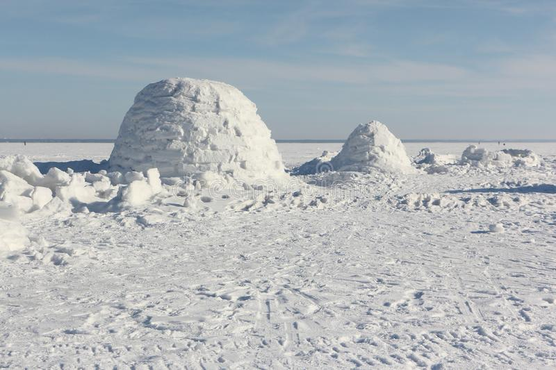 Igloo standing on a snowy glade. In the winter stock photos