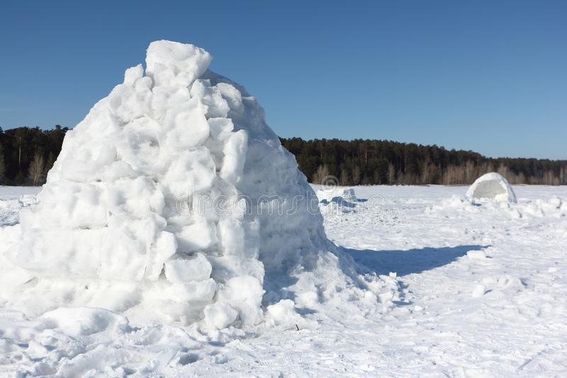 Igloo standing on a snowy glade. In the winter royalty free stock photo