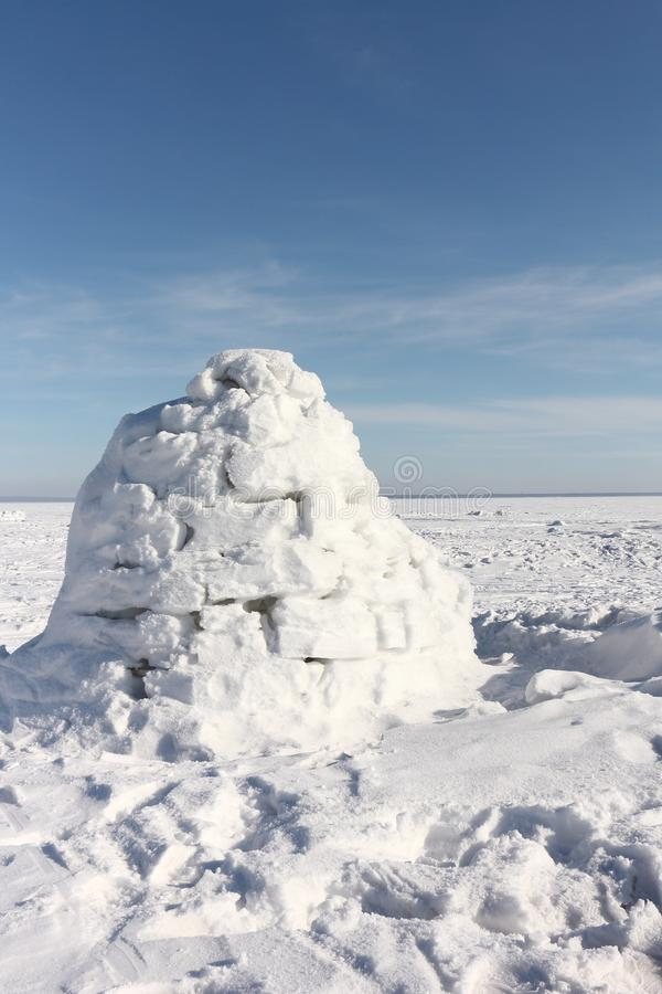 Igloo standing on a snowy glade. In the winter royalty free stock photography