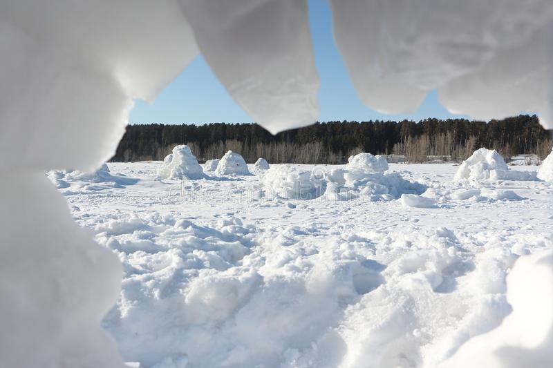 Igloo standing on a snowy glade stock photo